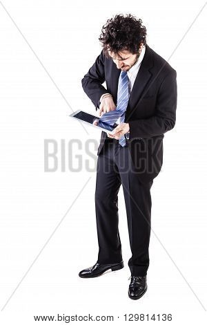 a young and handsome businessman holding a tablet isolated over a white background