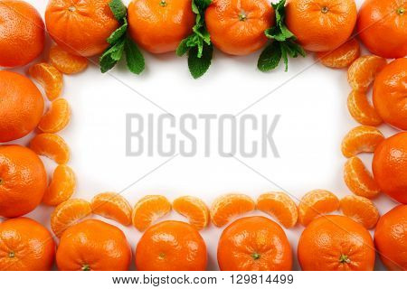 Fresh tangerines and mint sprigs isolated on white background, top view