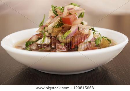 Traditional bowl of ecuadorian encebolladas, very nice presentation, restaurant catering concept.