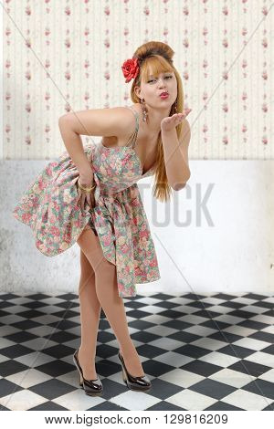 a pretty young pinup girl sending kisses