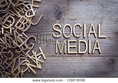 Social media and network concept wood letters on wooden background