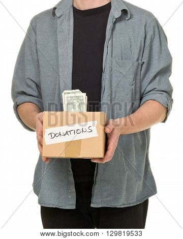 Man holding donation cardboard box with dollar banknotes over white background