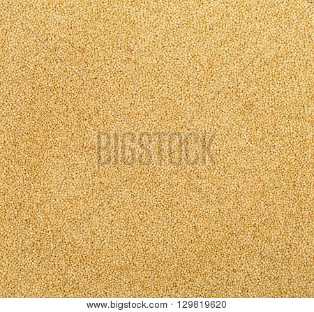 Frame filling raw uncooked amaranth seeds background
