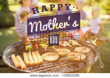 mothers day greeting against happy family eating barbecue