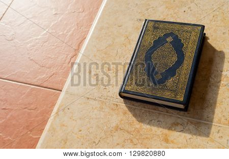 Holy Quran On Ceramic Background