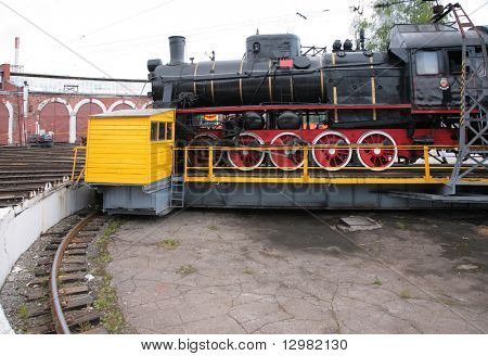 Steam locomotive in museum by side on turntable