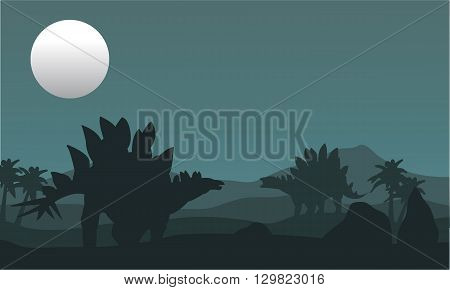 stegosaurus and moon silhouette at the night