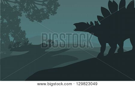 Single stegosaurus silhouette in hills beautiful scenery