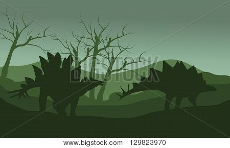 Silhouette of two stegosaurus with green backgrounds