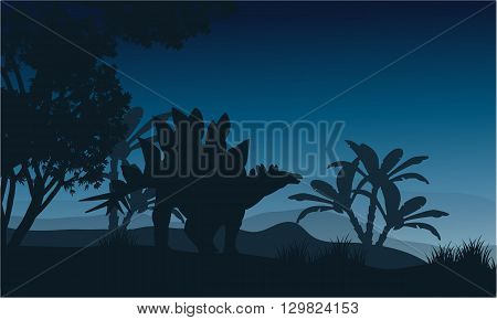 Silhouette of one stegosaurus in fields at night