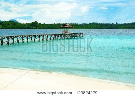 Beach And Wooden Dock On Bolilanga Island