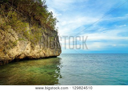 Sea Cliff On Bolilanga Island. Togean Islands