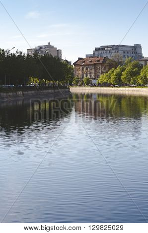 Bucharest, ROMANIA - April 22 2016: View of Dambovita river and old houses in Izvor area, near the Parliament building. BUCHAREST -April 22 2016