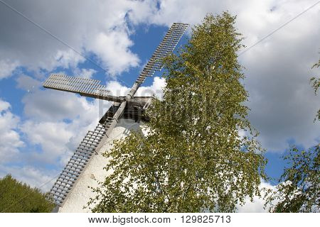 An old windmill in Estonia over blue sky background