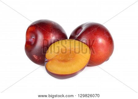ripe ruby plum fruit on white background