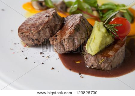 Mignon beef steak with potato garnish and sauce