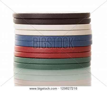 A stack of colorful casino chips isolated on white background.