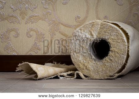 cut the tissue roll on the floor on the background Wallpaper