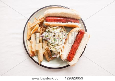 grilled hot dogs on fresh buns with hand cut fries and tasty cole slaw