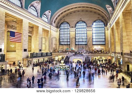 NEW YORK, UNITED STATES - NOVEMBER 1, 2015: The floor of the main hall in Grand Central Station in New York City with passengers and tourists moving around as trains arrive and depart.