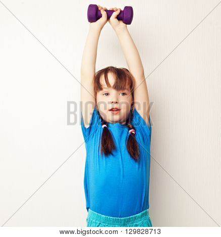 girl working out with dumbbells at home
