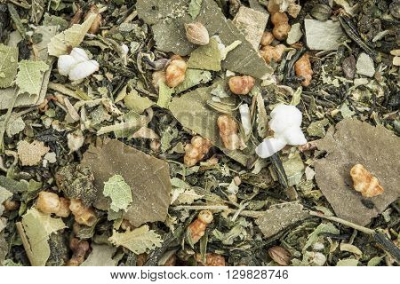 weight loss and detox herbal tea with oolong tea, lotus leaf, rice tea, green tea, Buddha tea,lemon balm and balsam pear - closeup background