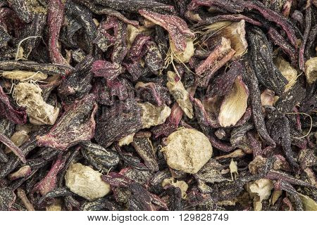 closeup background of a blood circulation and metabolism herbal tea including hibiscus and ginger