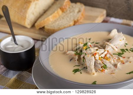 Romanian chicken soup named Ciorba Radauteana on plate