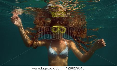 Attractive young woman floating in ocean