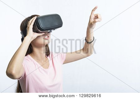 woman using the virtual reality headset on white background