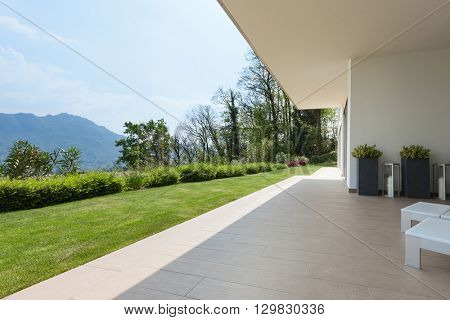 exterior of a new house, veranda with green lawn