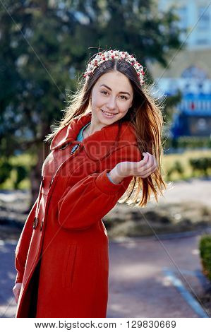 Outdoors fashion portrait of beautiful brunette woman, posing on a city street.