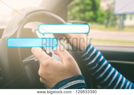 Female driving car and texting on smartphone with speech bubbles as copy space for message using mobile phone in traffic.