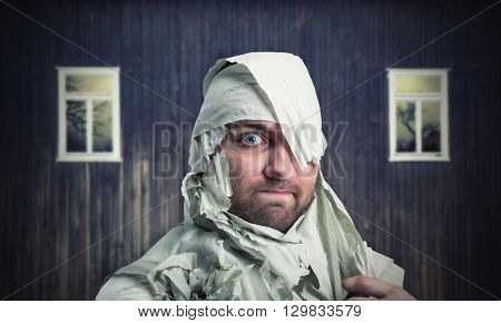 Man in toilet paper in neglected room