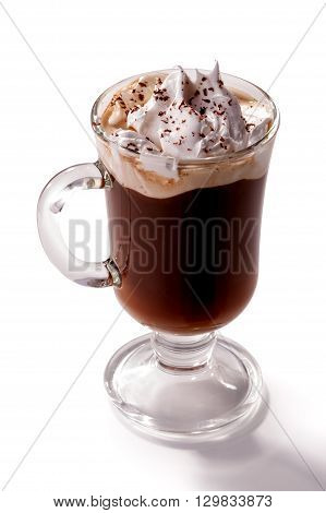 glass of Viennese coffee topped with whipped cream and chocolate chips close-up isolated on white background