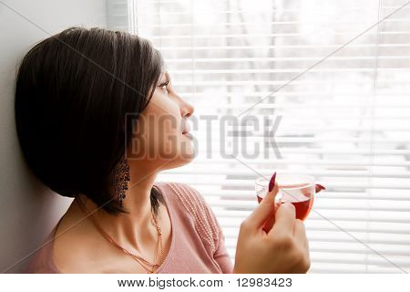 Brunette Woman Look At Window And Relaxing With Hot Tea