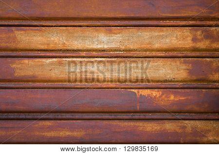 Close-up metallic pattern of rusty gate. Grunge tones.