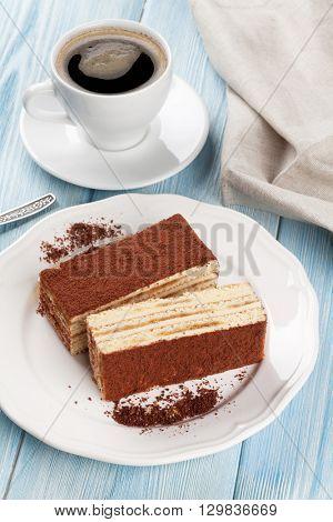 Tiramisu dessert and coffee on wooden table