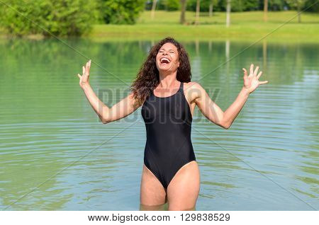Young Woman Standing In A Lake