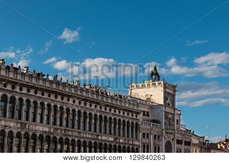 Procuratie Vecchie's Arcades And Torre Dell'orologio In Saint Mark's Square In Venice, Italy