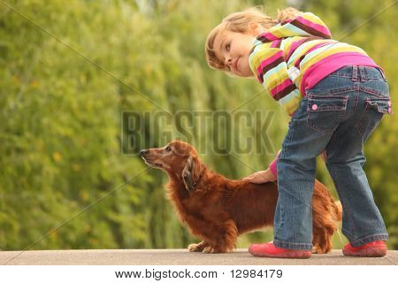 little girl  and her dachshund