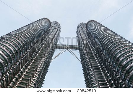 KUALA LUMPUR MALAYSIA - MAY 08 2016 : The Petronas Towers also known as the Petronas Twin Towers KLCC are twin skyscrapers in Kuala Lumpur Malaysia.
