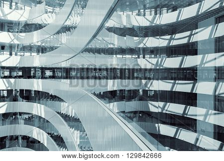 Colorized picture of abstract looking interior of modern business center