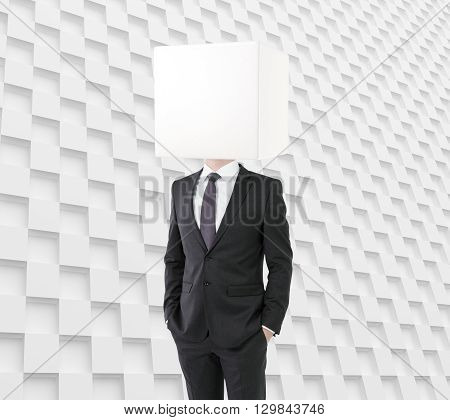 Businessman with box instead of head on patterned background