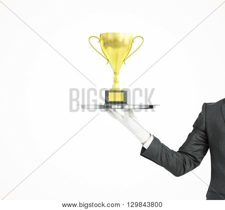 Businessman isolated on white backgrond holding tray with golden cup trophy
