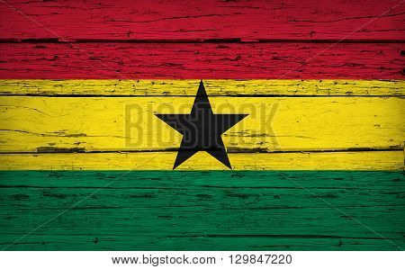Ghana grunge wood background with Ghanaian flag painted on aged wooden wall.