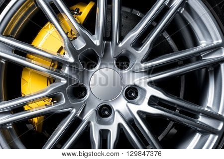 Car detailing series : Closeup of clean super car wheel and disc-brake