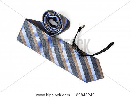 Striped necktie for men with black digital watch on the white background. Beauty and fashion. Style of modern man.