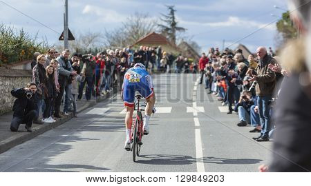 Conflans-Sainte-HonorineFrance-March 62016: The French cyclist Arnaud Demare of FDJ Team riding during the prologue stage of Paris-Nice 2016.