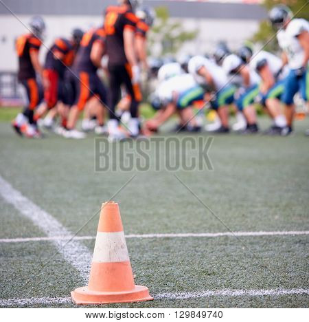 American football match focus on traffic cone